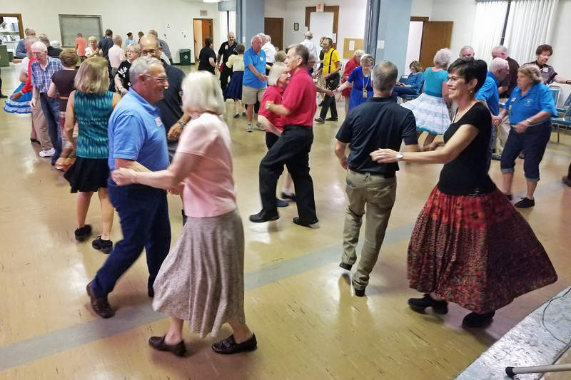 Dancing at Singles & Doubles Square Dance Club